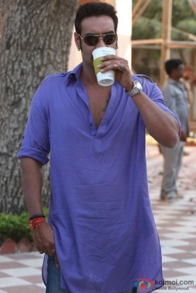 Ajay Devgan taking a drink in Bol Bachchan Movie Stills