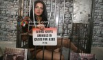 Celina Jaitly In A Cage For PETA Campaign