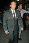 Salman Khan in a black suit and tie