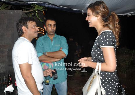 Image & Caption: Heroine-Director: Kangana Ranaut and Ram Gopal Varma share a joke.