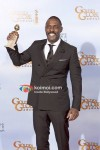 Elba Poses At Golden Globe 2012 Winners Portrait
