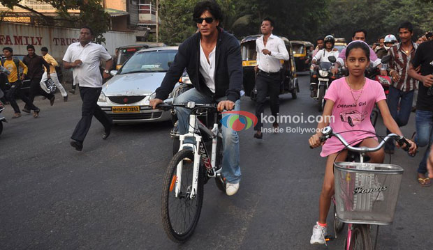 Shah Rukh Khan takes a bike ride with his daughter.