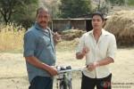 Nana Patekar and Shreyas Talpade holding a bicycle in Kamaal Dhamaal Malamaal Movie Stills