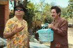 Paresh Rawal and Shakti Kapoor holding a picnic basket in Kamaal Dhamaal Malamaal Movie Stills