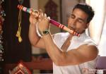 Akshay Kumar playing the flute in OMG Oh My God! Movie Stills