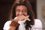 Mithun Chakraborty giving a weird smile in OMG Oh My God! Movie Stills