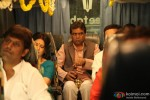Paresh Rawal Opens A Bottle In OMG Oh My God! Movie Stills