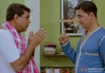 Paresh Rawal folding hands in front of God Akshay Kumar in OMG Oh My God Movie Stills