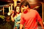Raima Sen try to hit a flower pot on Sharman Joshi in 3 Bachelors Movie Stills