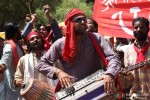 Abhay Deol playing an instrument while protesting in Chakravyuh Movie Stills