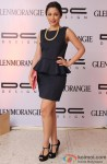 Amrita Puri poses during the show of Glenmorangie