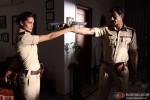 Esha Gupta and Arjun Rampal pulling guns on each other in Chakravyuh Movie Stills