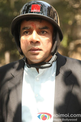 Paresh Rawal in a Still from OMG Oh My God! Movie