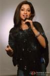 Shreya Ghoshal strikes a pose with a mic