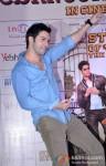 Varun Dhawan Unveils Movie Merchandise At Infiniti Mall In Mumbai