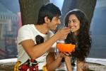 Kartik Tiwari offers a food to Nushrat Bharucha in Akaash Vani Movie Stills