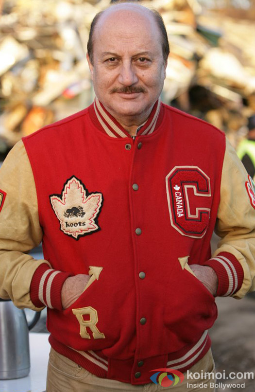 Anupam Kher poses for the shutter bugs in a red and beige jacket
