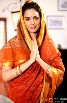 Mallika Sherawat Poses In A Saree