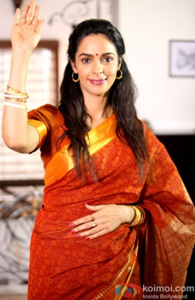 Mallika Sherawat Waves In A Traditional Avatar