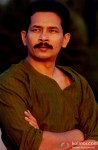 Atul Kulkarni gives an intense look here