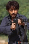Irrfan Khan Points The Gun In A Still From His Film