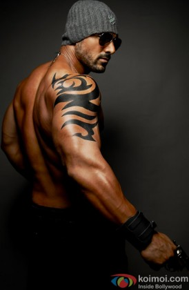John Abraham Snapped Flaunting His Tattoo