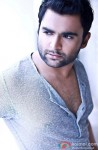 Sachiin Joshi poses for the shutterbugs