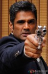 Sunil Shetty Snapped Pointing A Gun