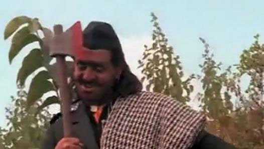 Gulshan Grover as a 'Kesariya Villayati' in a still from movie 'Ram Lakhan'