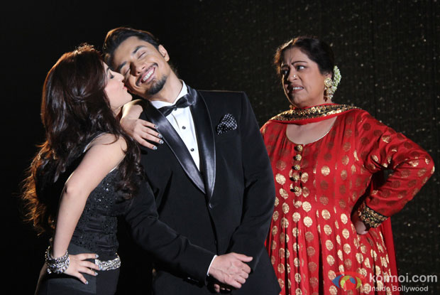 Yami Gautam, Ali Zafar and Kirron Kher in a still from movie 'Total Siyapaa'