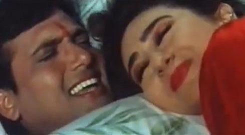 Govinda and Karisma Kapoor in a still from movie 'Raja Babu'