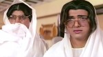 Shakti Kapoor and Govinda in a still from movie 'Raja Babu (1994)'