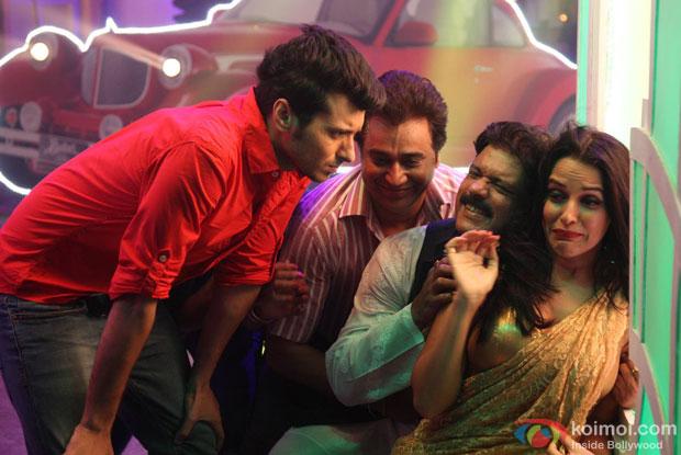 Divyendu Sharma, Manu Rishi Chadha, Rajesh Sharma and Neha Dhupia in a still from movie 'Ekkees Toppon Ki Salaami'