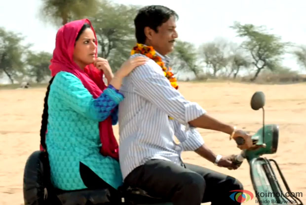 Mona Singh and Adil Hussain in a still from movie ' Zed Plus'