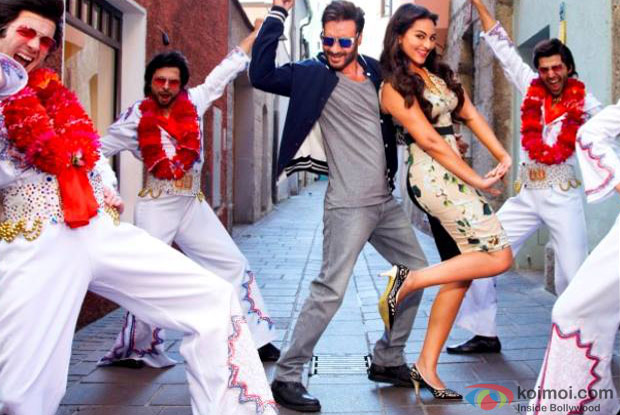Ajay Devgn and, Sonakshi Sinha in a still from movie 'Action Jackson'