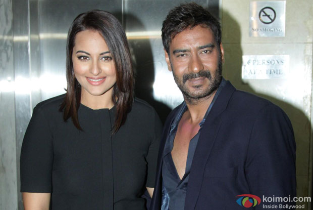 Sonakshi Sinha and Ajay Devgn at an event
