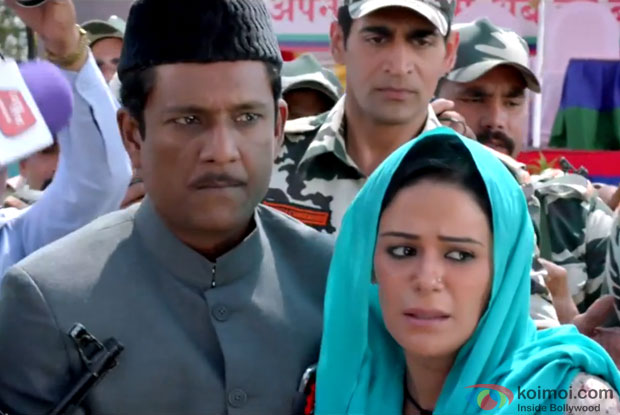Adil Hussain and Mona Singh in a still from movie 'Zed Plus'