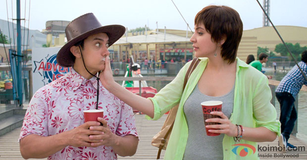 Aamir Khan and Anushka Sharma in a 'Love Is A Waste Of Time' song still from movie 'PK'