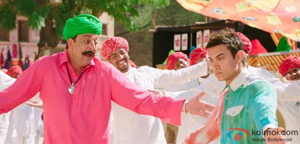 Sanjay Dutt and Aamir Khan in a 'Tharki Chokro' song still from movie 'PK'