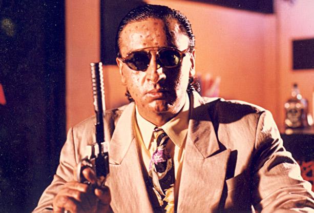 Gulshan Grover as  Chhappan Tikli a.k.a. Jimmy in a still from movie 'Sir (1993)'
