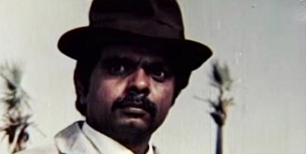 Sadashiv Amrapurkar as Deenbandhu Deenanath (DBDN) in a still from movie 'Hukumat (1987)'