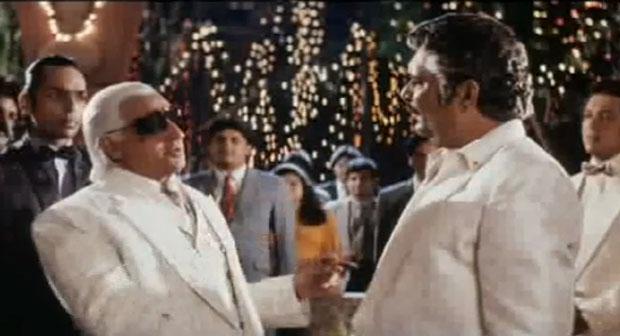 Gulshan Grover as Tyson in a still from movie 'Mohra (1994)'