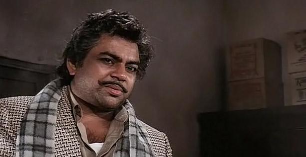 Paresh Rawal as Teja in a still from movie 'Andaz Apna Apna (1994)'
