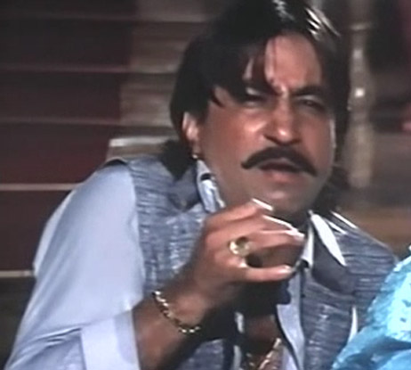 Shakti Kapoor as Batuknath Lalanprasad Maalpani/Balma in a still from movie 'ChaalBaaz (1989)'