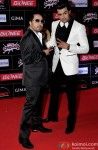 Mika Singh and Manish Paul during the GiMA Awards 2015