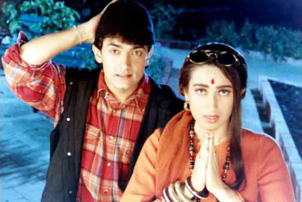 Aamir Khan and Karisma Kapoor in a still from movie 'Raja Hindustani (1996)'