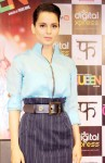 Kangana Ranaut sported a blue silk zip-up top and high waist pencil skirt