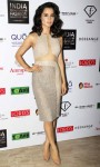 Kangana Ranaut in a shimmering beige color knee length dress