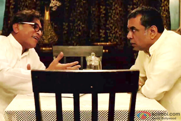 Annu Kapoor and Paresh Rawal in a still from movie 'Dharam Sankat Mein'