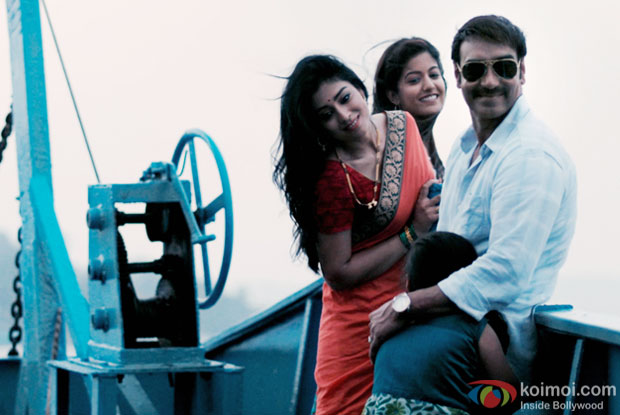 Shriya Saran and  Ajay Devgn in a still from movie 'Drishyam'